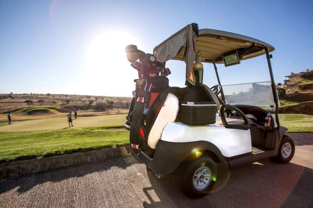 Golf cart on golf course.