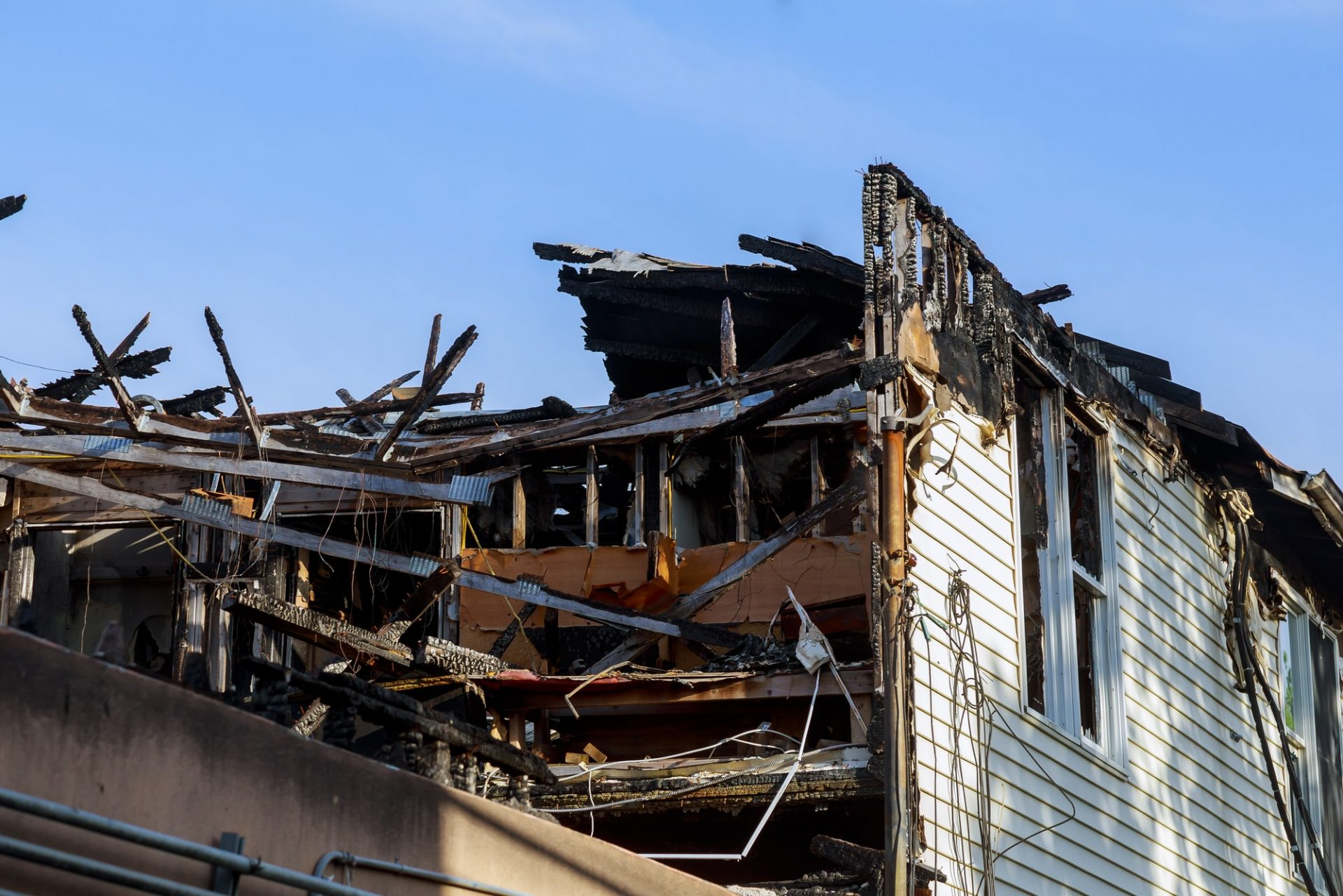 Ruins of house after big disaster - fire day the fire House in the city