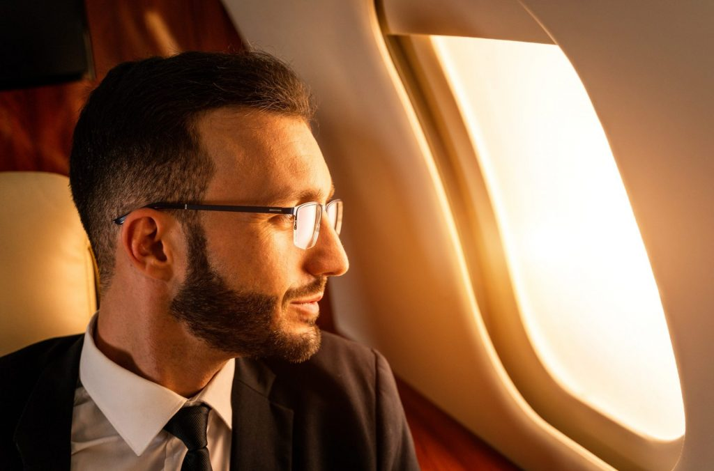Businessman flying on private jet